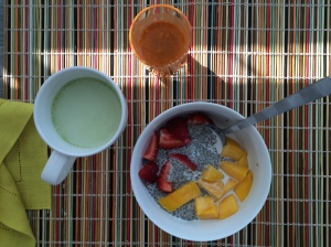Chilled chia porridge with sliced mango and strawberries, a drizzle of soy milk, fresh pressed juice and matcha.  Set for the day (or at least until lunch!).