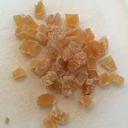Candied ginger about to be diced into quarters